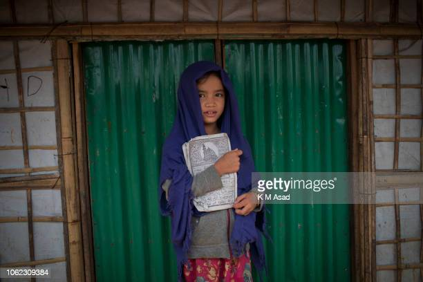 Rohingya refugee girl comes from Islamic school education at Hakimpara Rohingya refugee camp in Coxs Bazar The UN rights chief on November 13 urged...