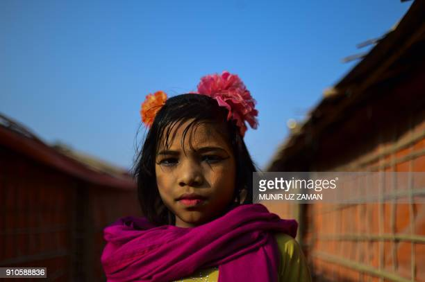 Rohingya refugee girl poses for a photo at Balukhali refugee camp in Bangladesh's Ukhia district on January 26 2018 The repatriation of hundreds of...