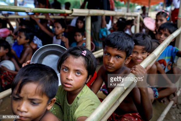 Rohingya refugee girl wait to collect food a refugee camp in Ukhiya Cox's Bazar According to the UNHCR more than 500000 Rohingya refugees have fled...