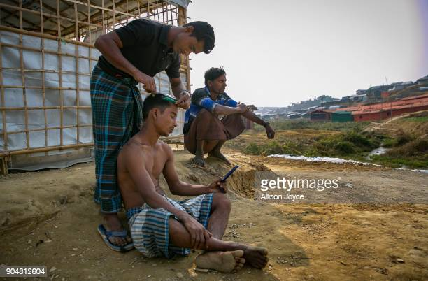 COX'S BAZAR BANGLADESH JANUARY 14 A Rohingya refugee has his hair cut in Balukhali camp on January 14 2018 in Cox's Bazar Bangladesh Over 650000...