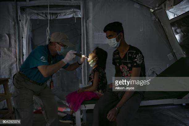 COX'S BAZAR BANGLADESH JANUARY 12 A Rohingya refugee is examined by a doctor at a Samaritan's Purse diphtheria clinic in Balukhali camp on January 12...