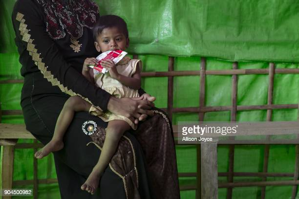 COX'S BAZAR BANGLADESH JANUARY 13 A Rohingya refugee is seen at a malnutrition center in Balukhali camp on January 13 2018 in Cox's Bazar Bangladesh...