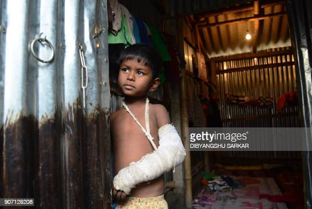Rohingya refugee looks out from a temporary shelter near the village of Baruipur some 55km south of Kolkata on January 19 2018 / AFP PHOTO /...