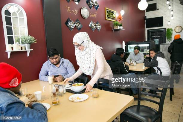 Rohingya refugee Naznin serves food at her mother's restaurant the Tea Leaf Garden restaurant on January 11 2019 in Chicago Illinois In 2018 Rohingya...