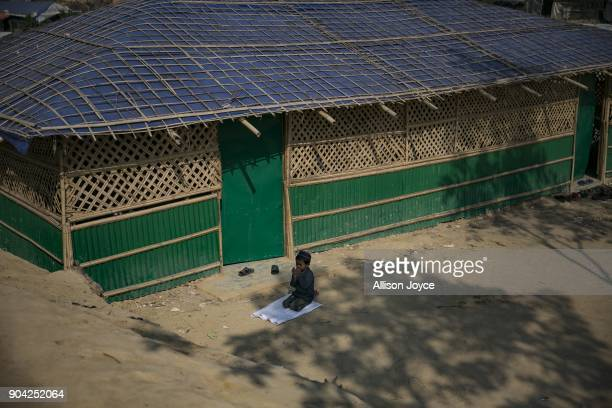 COX'S BAZAR BANGLADESH JANUARY 12 A Rohingya refugee performs Friday prayer in Balukhali camp on January 12 2018 in Cox's Bazar Bangladesh Over...