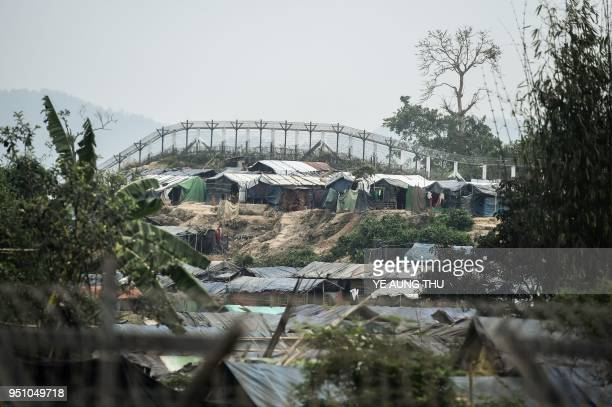 Rohingya refugee shelters are seen in the 'no man's land' behind Myanmar's boder lined with barb wire fences in Maungdaw district Rakhine state...