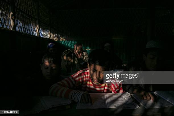 COX'S BAZAR BANGLADESH JANUARY 11 Rohingya refugee study the Koran at a school in Balukhali camp on January 11 2018 in Cox's Bazar Bangladesh Over...