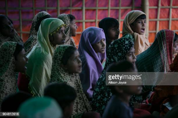 COX'S BAZAR BANGLADESH JANUARY 14 Rohingya refugee study the Koran in Balukhali camp on January 14 2018 in Cox's Bazar Bangladesh Over 650000...