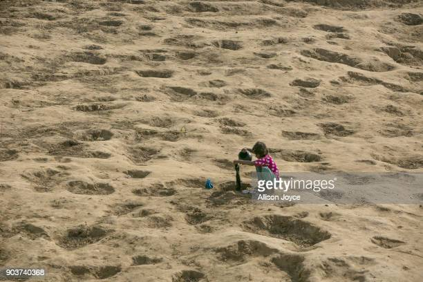 COX'S BAZAR BANGLADESH JANUARY 11 A Rohingya refugee washes her clothes in a water hole in the group in Balukhali camp on January 11 2018 in Cox's...