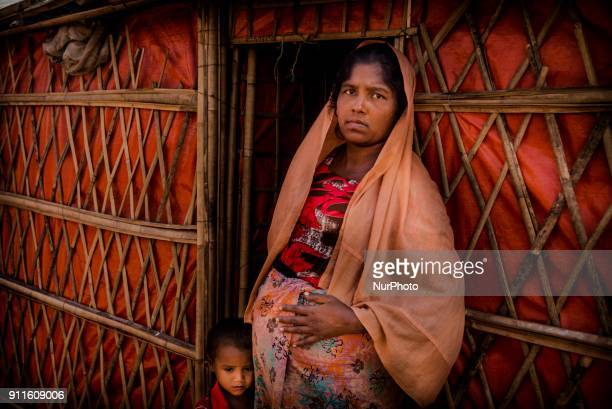A Rohingya refugee woman poses for a photo at Cox's Bazar refugee camp in Bangladesh on January 27 2018 As the rohingya people are refused from...
