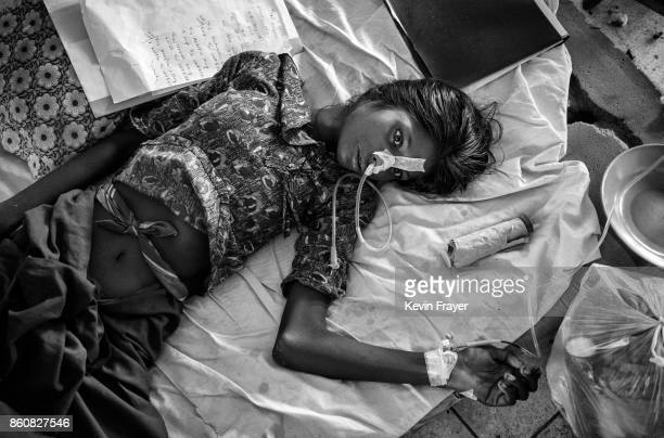 COX'S BAZAR BANGLADESH OCTOBER 03 A Rohingya refugee woman suffering from malnutrition and diarrhea lays in the Rohingya Ward at Sader Hospital on...