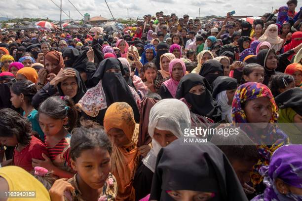 Rohingya refugee women gather in the open field at kutupalong refugee camp to commemorate the second anniversary of the 2017 crisis when they were...