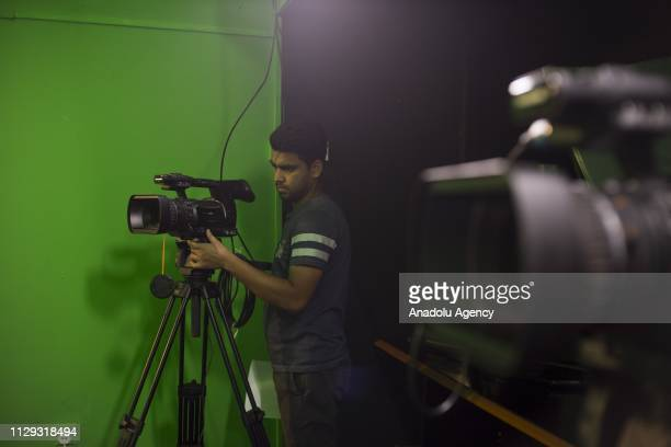 Rohingya refugee Zaker Ahmad prepares the camera prior to the recording session at Rohingya Vision TV studio in Kuala Lumpur Malaysia on March 07...