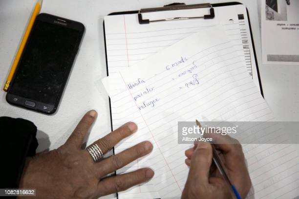 Rohingya refugees Abdullah Rahman participates in an English class at the Rohingya Cultural Center of Chicago on January 10 2019 in Chicago Illinois...