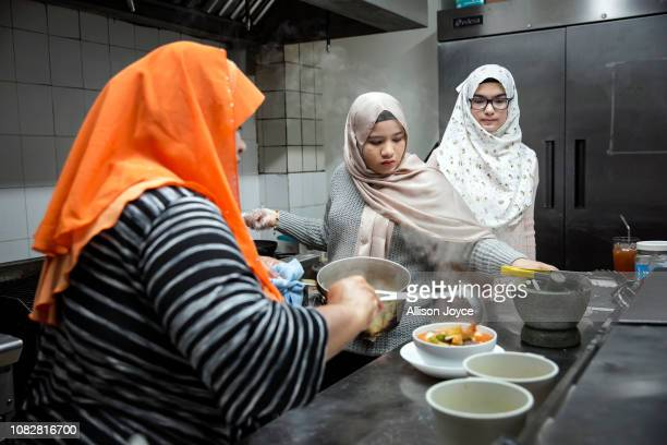 Rohingya refugees Aisha and Naznin work at their mother's restaurant the Tea Leaf Garden restaurant on January 11 2019 in Chicago Illinois In 2018...