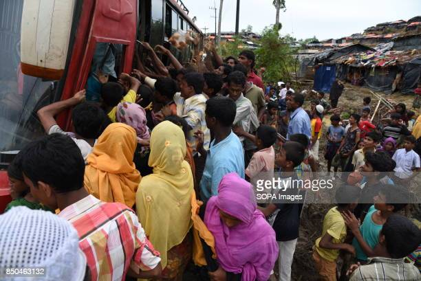 Rohingya refugees are gathered in a relief loaded bus to get reliefs giving by the social organization from Chittagong Though the reliefs for the...