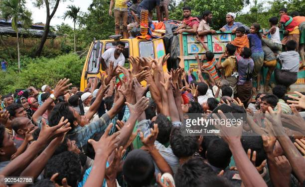 PALONGKHALI COXBAZAR BANGLADESH Rohingya refugees are heart and soul trying to get reliefs giving by the social organization from Chittagong Though...