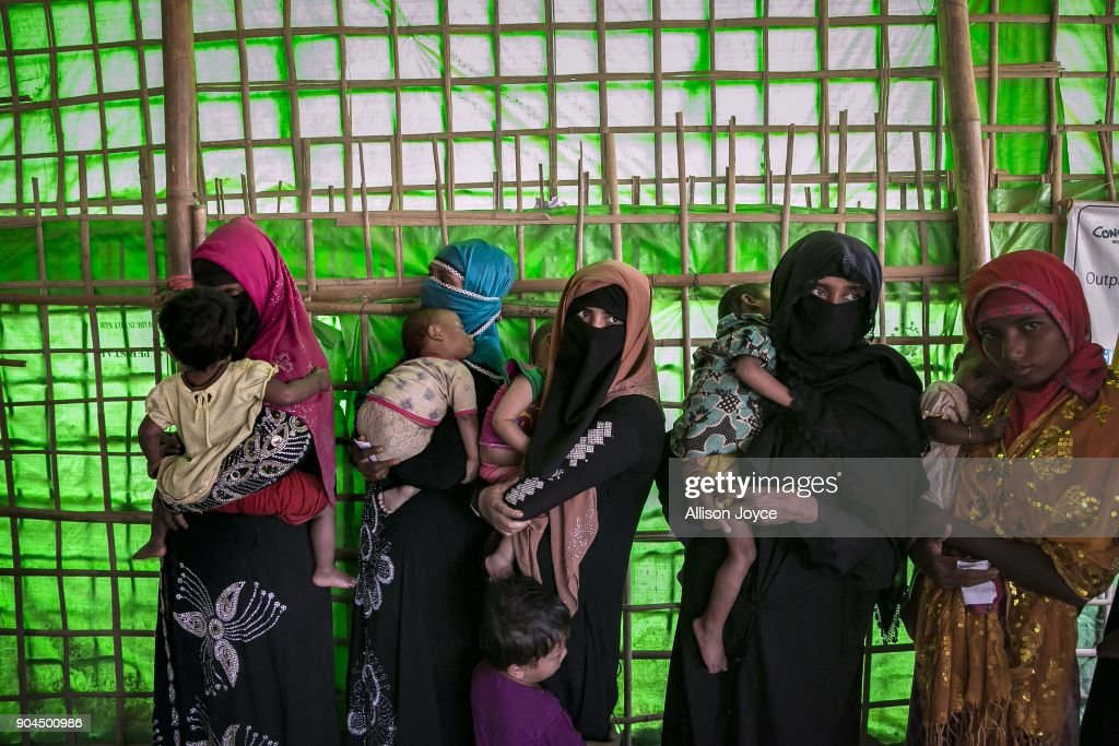COX'S BAZAR, BANGLADESH - JANUARY 13: Rohingya refugees are seen at a malnutrition center in Balukhali camp on January 13, 2018 in Cox's Bazar, Bangladesh. Over 650,000 Rohingya have crossed the border to Bangladesh since August last year, fleeing the violence at Rakhine State when their villages were attacked and many worry that they will face further reprisals if they return to Myanmar. The refugee camps in Bangladesh no longer seem temporary as thousands of tents made of plastic and bamboo spread across the undulating terrain and long wooden bridges connect parts of the camps divided by water. Existing camps such as Nayapara and Kutupalong have swelled to accommodate the new arrivals since the Myanmar military began its campaign in late August while the Rohingya queue for hours to get rations due to little access to clean water, health care or food and the refugee camps turn into mud-baths whenever it rains. International aid groups and health workers have estimated at least 6,700 Rohingya had met with violent deaths and warn of potential outbreaks of cholera and other preventable diseases due to squalid conditions.