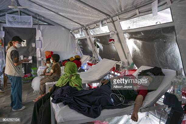 COX'S BAZAR BANGLADESH JANUARY 12 Rohingya refugees are seen at a Samaritan's Purse diphtheria clinic in Balukhali camp on January 12 2018 in Cox's...