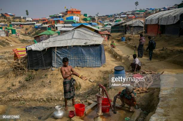 COX'S BAZAR BANGLADESH JANUARY 14 Rohingya refugees are seen at a well in Balukhali camp on January 14 2018 in Cox's Bazar Bangladesh Over 650000...