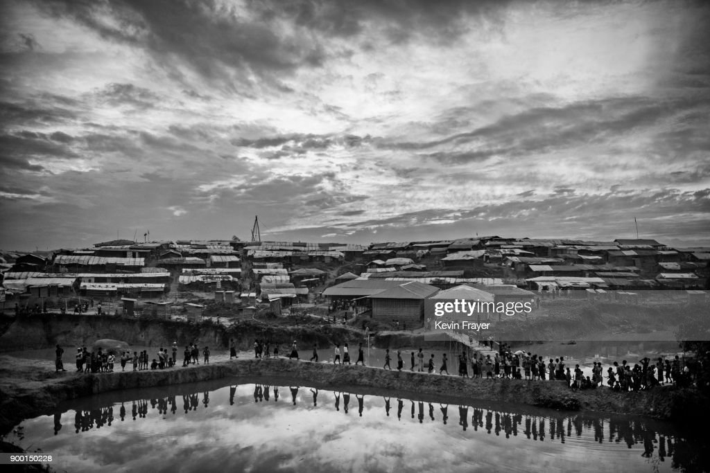 "COX'S BAZAR, BANGLADESH - OCTOBER 31: Rohingya Refugees are seen at the Kutupalong Refugee Camp on October 31, 2017 near Cox's Bazar, Bangladesh. More than 600,000 Rohingya refugees have flooded into Bangladesh to flee an offensive by Myanmar's military that the United Nations has called ""a textbook example of ethnic cleansing"". The refugee population continues to swell further, with thousands more Rohingya Muslims making the perilous journey on foot toward the border, or paying smugglers to take them across by water in wooden boats. Hundreds are known to have died trying to escape, and survivors arrive with horrifying accounts of villages burned, women raped, and scores killed in the ""clearance operations"" by Myanmar's army and Buddhist mobs that were sparked by militant attacks on security posts in Rakhine state on August 25, 2017. What the Rohingya refugees flee to is a different kind of suffering in sprawling makeshift camps rife with fears of malnutrition, cholera, and other diseases. Aid organizations are struggling to keep pace with the scale of need and the staggering number of them — an estimated 60 percent — who are children arriving alone. Bangladesh, whose acceptance of the refugees has been praised by humanitarian officials for saving lives, has urged the creation of an internationally-recognized ""safe zone"" where refugees can return, though Rohingya Muslims have long been persecuted in predominantly Buddhist Myanmar. World leaders are still debating how to confront the country and its de facto leader, Aung San Suu Kyi, a Nobel Peace Prize laureate who championed democracy, but now appears unable or unwilling to stop the army's brutal crackdown. During a recent visit to Myanmar, U.S Secretary of State Rex Tillerson called for a ""credible"" probe into human rights violations against the Rohingya but said he would advise against full sanctions on the country."