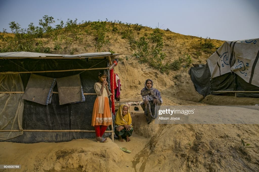 COX'S BAZAR, BANGLADESH - JANUARY 13: Rohingya refugees are seen in Balukhali camp on January 13, 2018 in Cox's Bazar, Bangladesh. Over 650,000 Rohingya have crossed the border to Bangladesh since August last year, fleeing the violence at Rakhine State when their villages were attacked and many worry that they will face further reprisals if they return to Myanmar. The refugee camps in Bangladesh no longer seem temporary as thousands of tents made of plastic and bamboo spread across the undulating terrain and long wooden bridges connect parts of the camps divided by water. Existing camps such as Nayapara and Kutupalong have swelled to accommodate the new arrivals since the Myanmar military began its campaign in late August while the Rohingya queue for hours to get rations due to little access to clean water, health care or food and the refugee camps turn into mud-baths whenever it rains. International aid groups and health workers have estimated at least 6,700 Rohingya had met with violent deaths and warn of potential outbreaks of cholera and other preventable diseases due to squalid conditions.
