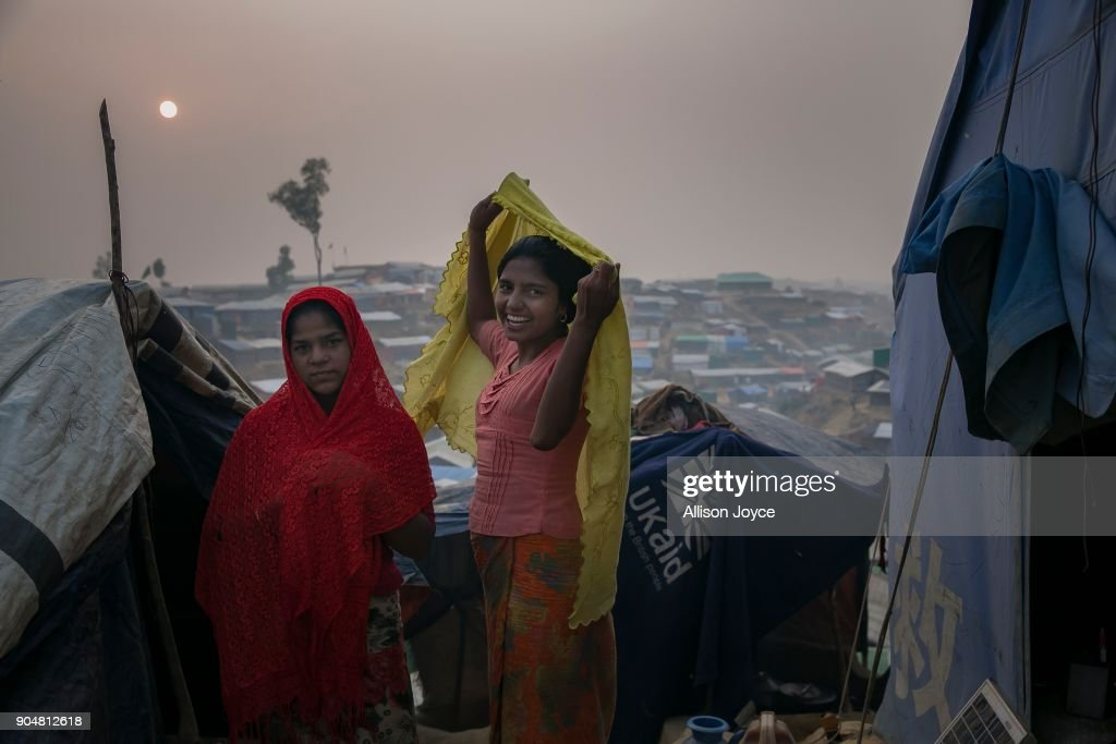 COX'S BAZAR, BANGLADESH - JANUARY 14: Rohingya refugees are seen in Balukhali camp on January 14, 2018 in Cox's Bazar, Bangladesh. Over 650,000 Rohingya have crossed the border to Bangladesh since August last year, fleeing the violence at Rakhine State when their villages were attacked and many worry that they will face further reprisals if they return to Myanmar. The refugee camps in Bangladesh no longer seem temporary as thousands of tents made of plastic and bamboo spread across the undulating terrain and long wooden bridges connect parts of the camps divided by water. Existing camps such as Nayapara and Kutupalong have swelled to accommodate the new arrivals since the Myanmar military began its campaign in late August while the Rohingya queue for hours to get rations due to little access to clean water, health care or food and the refugee camps turn into mud-baths whenever it rains. International aid groups and health workers have estimated at least 6,700 Rohingya had met with violent deaths and warn of potential outbreaks of cholera and other preventable diseases due to squalid conditions.