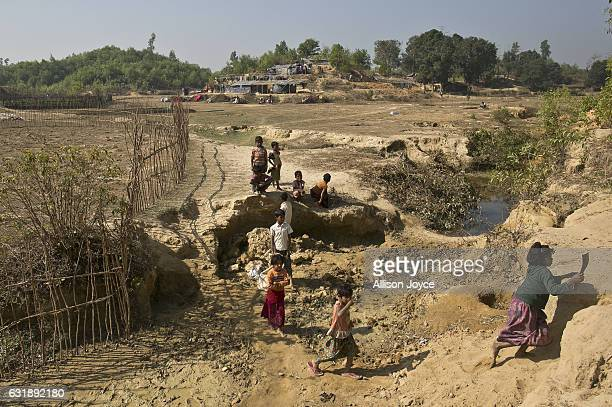 Rohingya refugees are seen in the Balu Kali camp on January 17 2017 in Cox's Bazar Bangladesh More than 65000 Rohingya Muslims have fled to...