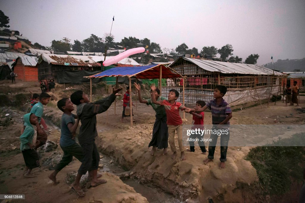 COX'S BAZAR, BANGLADESH - JANUARY 13: Rohingya refugees are seen in Uchiprang camp on January 13, 2018 in Cox's Bazar, Bangladesh. Over 650,000 Rohingya have crossed the border to Bangladesh since August last year, fleeing the violence at Rakhine State when their villages were attacked and many worry that they will face further reprisals if they return to Myanmar. The refugee camps in Bangladesh no longer seem temporary as thousands of tents made of plastic and bamboo spread across the undulating terrain and long wooden bridges connect parts of the camps divided by water. Existing camps such as Nayapara and Kutupalong have swelled to accommodate the new arrivals since the Myanmar military began its campaign in late August while the Rohingya queue for hours to get rations due to little access to clean water, health care or food and the refugee camps turn into mud-baths whenever it rains. International aid groups and health workers have estimated at least 6,700 Rohingya had met with violent deaths and warn of potential outbreaks of cholera and other preventable diseases due to squalid conditions.