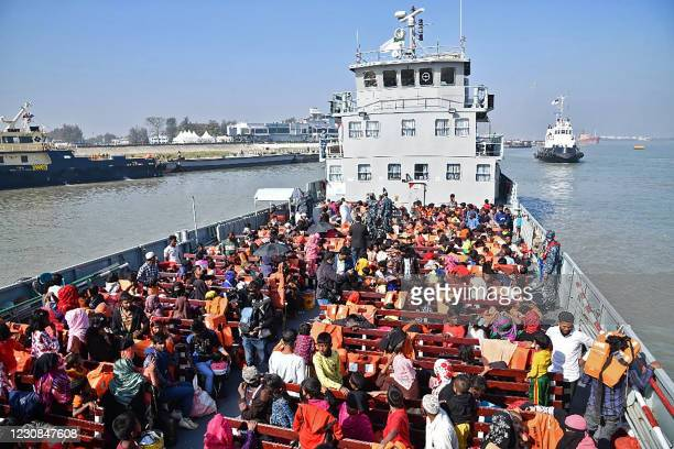 Rohingya refugees are seen on a Bangladesh's Navy ship as they are being relocated to Bhashan Char Island in the Bay of Bengal, in Chittagong on...