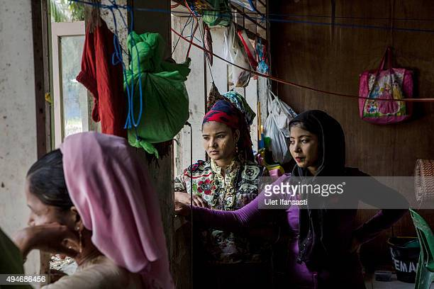 Rohingya refugees Asyah center looks out the window at a temporary shelter in Bayeun as some 1000 Rohingya Muslims remain in limbo on October 27 2015...