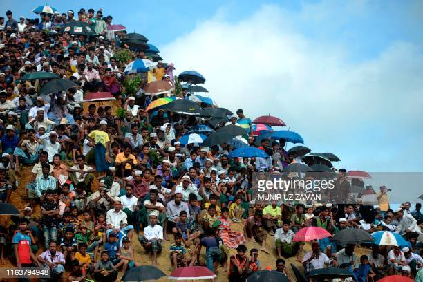 TOPSHOT Rohingya refugees attend a ceremony organised to remember the second anniversary of a military crackdown that prompted a massive exodus of...