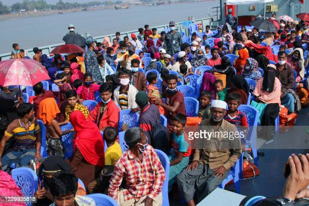 Rohingya refugees board a Bangladesh Navy ship to be transported to the island of Bhashan Char in Chittagong on December 4, 2020. - Bangladesh began...