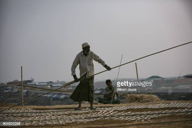 COX'S BAZAR BANGLADESH JANUARY 13 Rohingya refugees build a structure in Balukhali camp on January 13 2018 in Cox's Bazar Bangladesh Over 650000...
