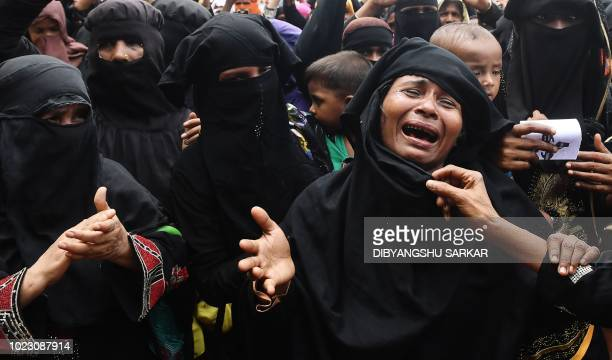 Rohingya refugees burst into tears during a protest march after attending a ceremony to remember the first anniversary of a military crackdown that...