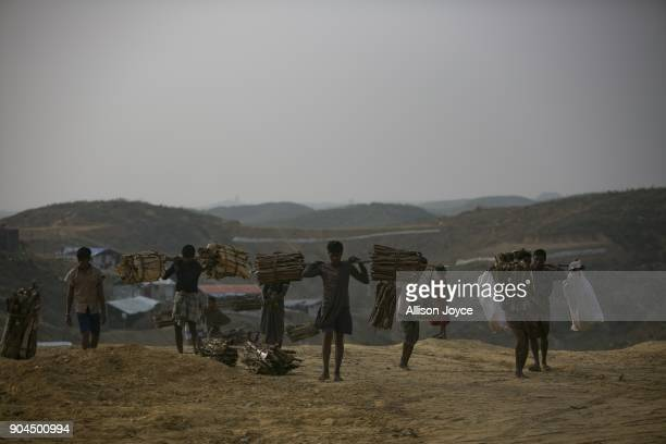 COX'S BAZAR BANGLADESH JANUARY 13 Rohingya refugees carry firewood in Balukhali camp on January 13 2018 in Cox's Bazar Bangladesh Over 650000...