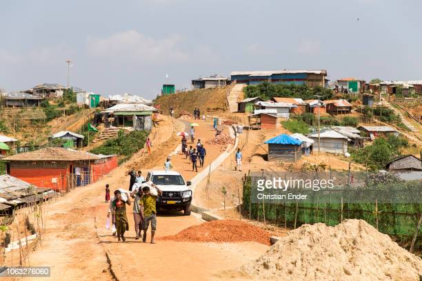 Kutupalong Ukhiya near Cox´s Bazar Bangladesh October 16 2018 Rohingya refugees carry goods on their shoulders in the refugee camp of the Rohingya...