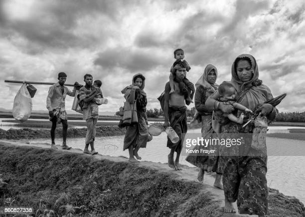 COX'S BAZAR BANGLADESH SEPTEMBER 24 Rohingya refugees carry their belongings as they walk after crossing the border on the Bangladesh side of the Naf...