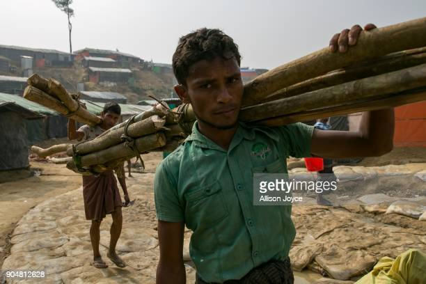 COX'S BAZAR BANGLADESH JANUARY 14 Rohingya refugees carry wood in Balukhali camp on January 14 2018 in Cox's Bazar Bangladesh Over 650000 Rohingya...