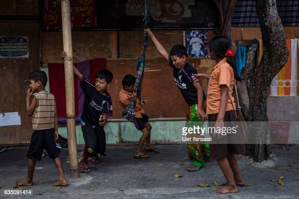 Rohingya refugees children play outside of their refugee camp on February 11 2017 in Medan North Sumatra Indonesia Thousands of Rohingya Muslims have...