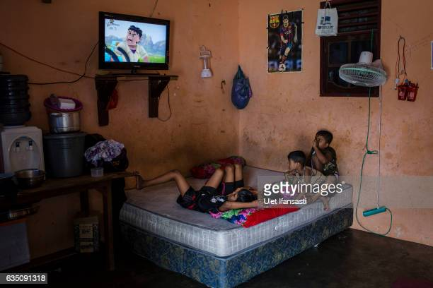 Rohingya refugees children watching movie inside of their refugee camp on February 11 2017 in Medan North Sumatra Indonesia Thousands of Rohingya...
