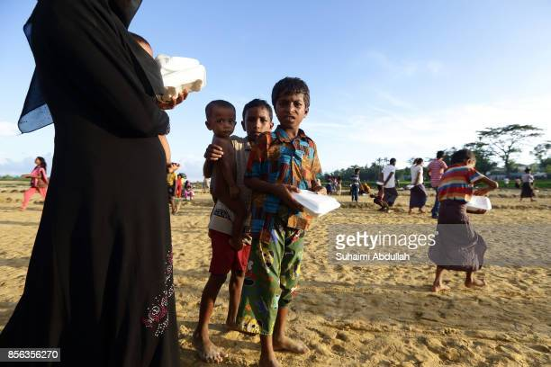 Rohingya refugees collect a precooked meal at the distribution point for food centre on September 30 2017 in Teknaf Cox's Bazar Bangladesh Over...