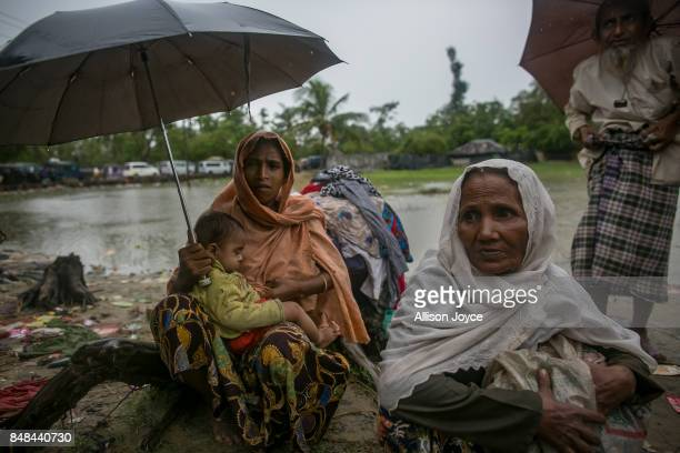 Rohingya refugees cross into the mainland after arriving in Bangladesh on September 17 2017 in Shah Porir Dwip Bangladesh Nearly 400000 Rohingya...