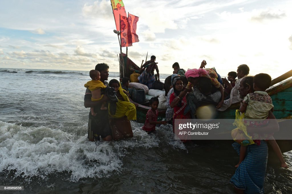 Rohingya refugees disembark from a boat after crossing the border from Myanmar, on the Bangladeshi shores of the Naf river in Teknaf on September 14, 2017. Bangladeshi boat operators are exploiting Rohingya Muslims fleeing violence in Myanmar by demanding up to $100 for ferry trips that usually cost 50 cents, as the United Nations warned September 14 of a 'worst case scenario' in which the entire minority group tries to escape the unrest. Some 389,000 Rohingya - including 10,000 in the past 24 hours -- have fled across the border since late August and there have been growing appeals for Myanmar's leader Aung San Suu Kyi to speak out in their defence. ZAMAN