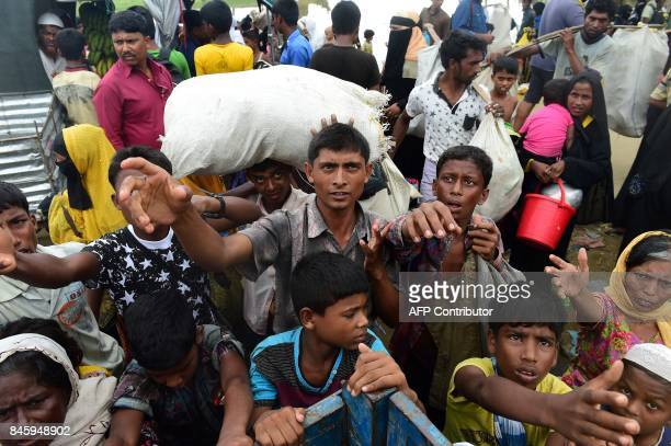 Rohingya refugees from Myanmar's Rakhine state wait for aid in the Bangladeshi town of Teknaf on September 12 2017 Some 370000 Rohingya have fled...