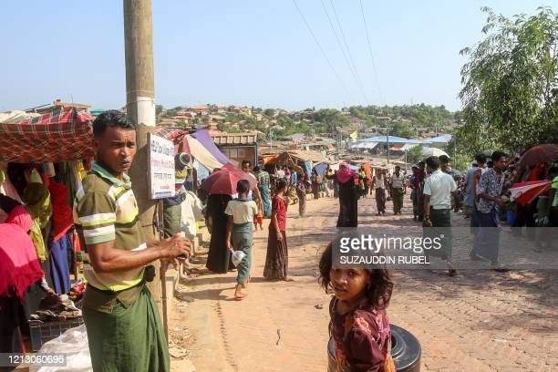 Rohingya refugees gather at a market as first cases of COVID19 coronavirus have emerged in the area in Kutupalong refugee camp in Ukhia on May 15...