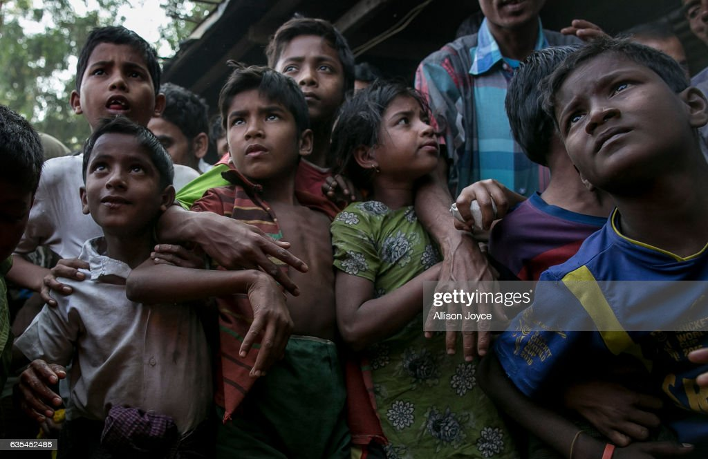 Rohingya refugees gather, hoping to get relief supplies donated by the crew of the Nautical Aliya in the Leda Rohingya refugee camp on February 15, 2017 in Chittagong, Bangladesh. The Rohingya aid ship, Nautical Aliya, carrying 2,200 tons of rice, emergency supplies and aid-workers, docked at Chittagong Port, about 140km from Cox's Bazar where thousands of Rohingya Muslims have taken refuge. Around 70,000 Rohingya Muslims have fled to Bangladesh from Myanmar since October last year after the Burmese army launched a campaign it calls 'clearance operations' in response to an attack on border police. According to reports, Bangladesh plans to proceed with a controversial plan to relocate tens of thousands of Rohingya refugees from Myanmar to a remote island in Bay of Bengal, despite warnings it is uninhabitable and prone to flooding. The Rohingya, a mostly stateless Muslim group numbering about 1.1 million, are the majority in Rakhine state and smaller communities in Bangladesh, Thailand and Malaysia.