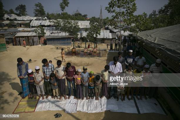 COX'S BAZAR BANGLADESH JANUARY 12 Rohingya refugees perform Friday prayer in Balukhali camp on January 12 2018 in Cox's Bazar Bangladesh Over 650000...