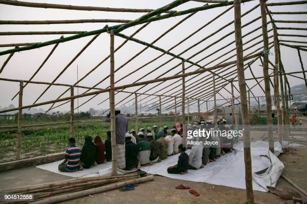 COX'S BAZAR BANGLADESH JANUARY 13 Rohingya refugees pray in Uchiprang camp on January 13 2018 in Cox's Bazar Bangladesh Over 650000 Rohingya have...