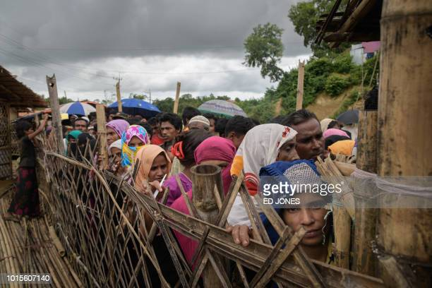 TOPSHOT Rohingya refugees queue at an aid relief distribution centre at the Balukhali refugee camp near Cox's Bazar on August 12 2018